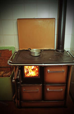 woodburning: antique stove a wood-burning Stove with fire lit in the old mountain home
