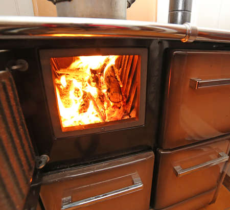 woodburning: antique stove a wood-burning Stove with fire lit in the mountain home