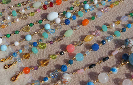 handcrafted: many valuable necklaces in gold and gemstones for sale at flea market