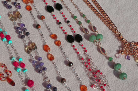 valuable: many valuable necklaces in gold and gemstones for sale Stock Photo