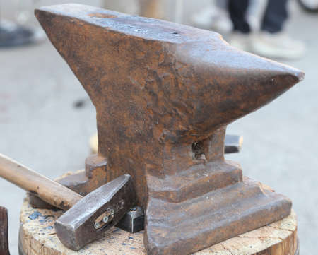 ferrous foundry: heavy ANVIL and sturdy HAMMER in the blacksmiths shop Stock Photo