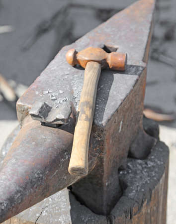ferrous foundry: Anvil and sturdy hammer in the workshop of the blacksmith