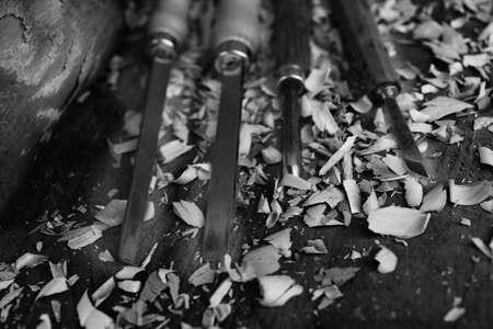chisels: expert Carpenter chisels sharp with wood chips after processing