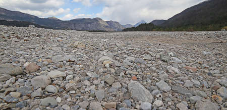 river bed: Immense gravel bed of the river bed completely without water with many cobblestone and rocks