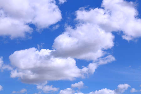 forecasts: bright white clouds in the blue clear sky in spring
