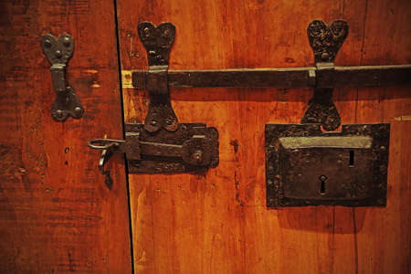 medieval blacksmith: ancient lock in a big wooden door of the medieval castle