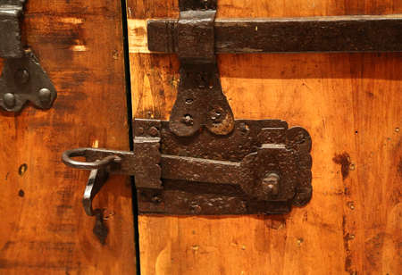 ancient blacksmith: ancient lock in a big wooden door of the medieval castle