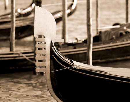 prow: detail of the prow of the Gondola in Venice in Italy sepia effect Stock Photo