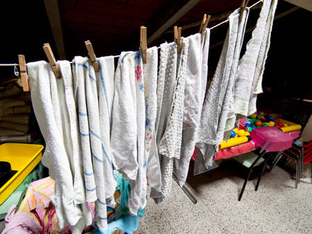 laundry room: many rags hung out to dry in the laundry room in the attic of a kindergarten