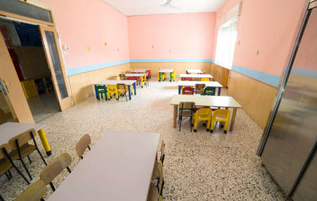 go inside: chairs and tables in the room of a canteen refectory of kindergarten