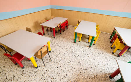 chairs and tables in the canteen of a refectory of kindergarten photo