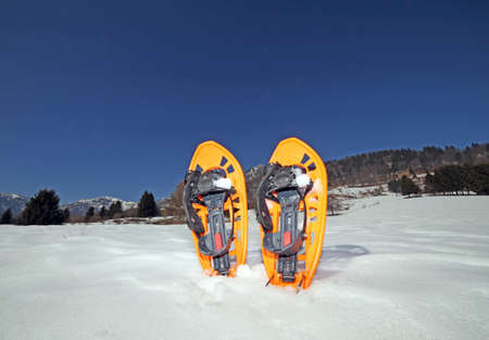 excursions: Orange SNOWSHOES for excursions on the snow in the mountains