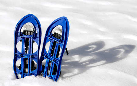 excursions: Blue SNOWSHOES for excursions on the snow in the mountains Stock Photo