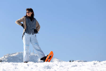 snowshoes: Pretty woman with snowshoes in the mountains in winter