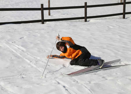 skiing accident: inexperienced boy trying for the first time the cross-country skiing and then he falls on snow Stock Photo