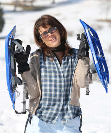 snowshoes: Nice woman with snowshoes in the mountains in winter