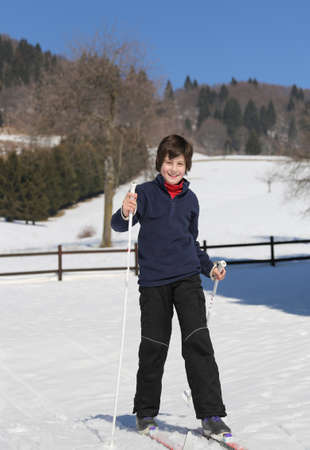 crosscountry: funny kid try cross-country skiing on the white snow in the mountains in winter Stock Photo