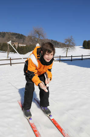crosscountry: pretty young boy goes on cross-country skiing on the white snow in winter Stock Photo