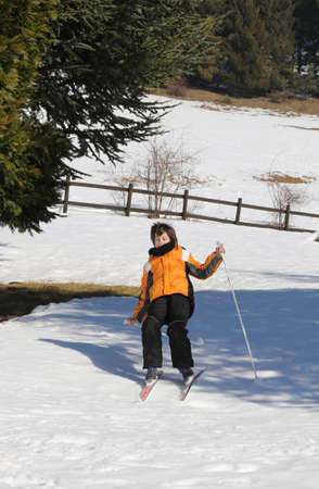 skiing accident: inexperienced boy trying for the first time the  cross-country skiing and then he falls on snow