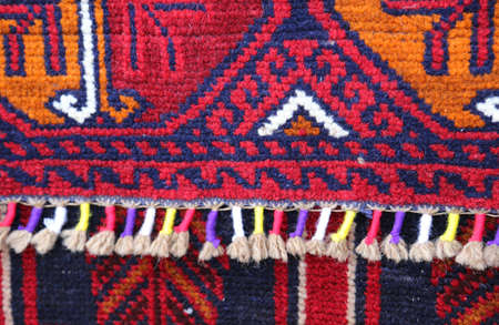 wool rugs: details of ancient Middle Eastern rugs handmade textile frame Stock Photo