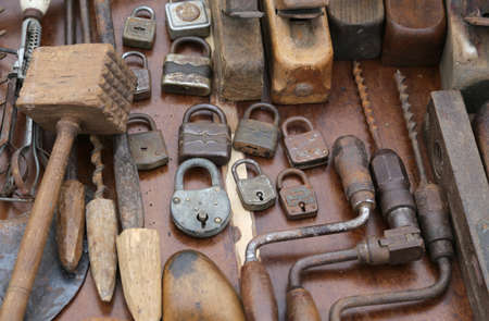 hand drill: hand drill old rusty padlocks and planers in the workshop of flea market