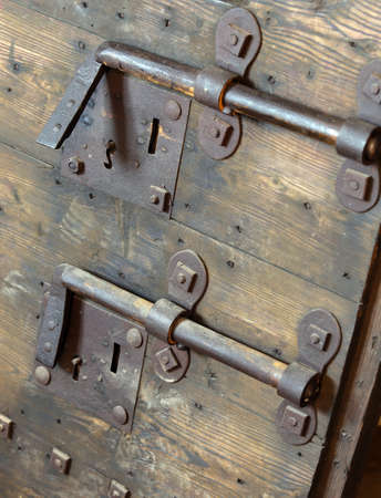 rusty lock with big deadbolt to close the door of the castle photo