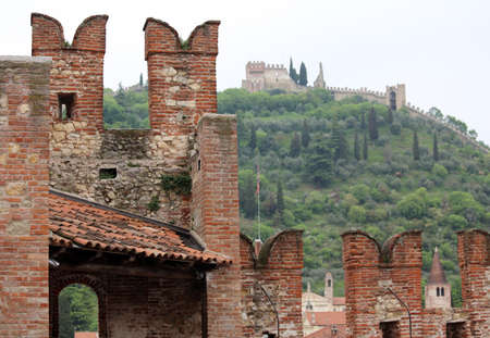 a war historian: walls of the castle with battlements for Defense and the upper Castle