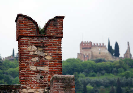 a war historian: great battlements of the castle on the walls to protect the medieval soldiers Editorial