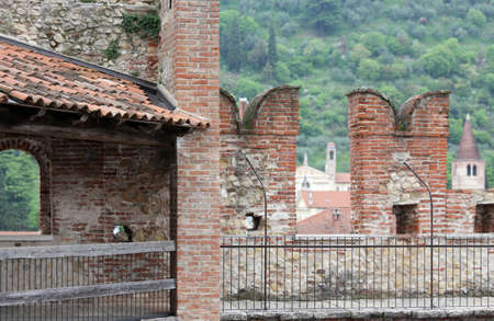 a war historian: ancient castle walls with big battlements for defense of the medieval Manor