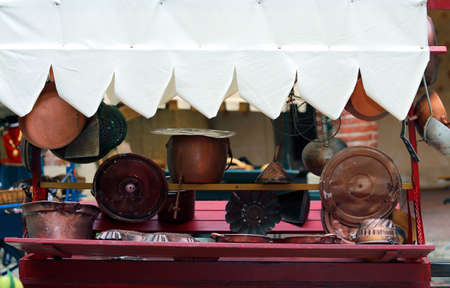 many copper objects for kitchen and home for sale in the antiques stall at flea market Stock Photo
