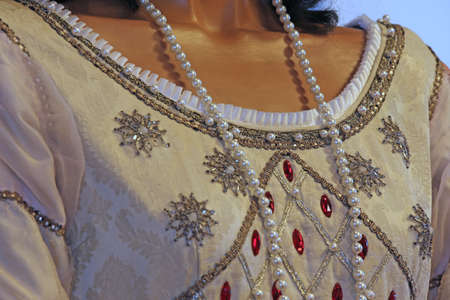 princely: ancient medieval princely dress used by the Queen with precious Pearl Necklace Stock Photo