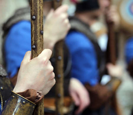 a war historian: soldiers with medieval uniforms with the old weapons in hand Stock Photo