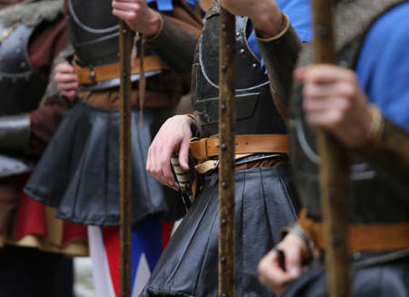 medieval reenactment with costumed characters and ancient clothes photo