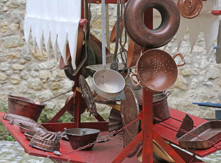 giftware: old collander and other old copper objects in cart for sale at flea market