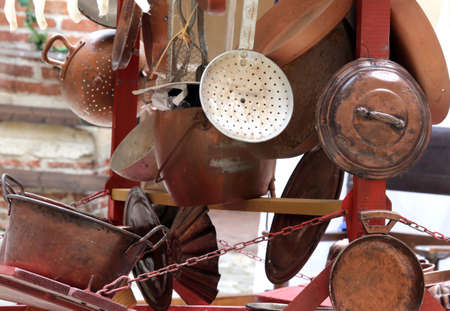 many copper objects for kitchen and home for sale in the antiques stall at flea market photo