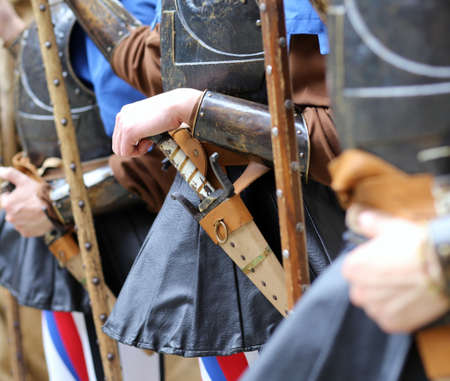 costumed: medieval reenactment with costumed characters and ancient clothes