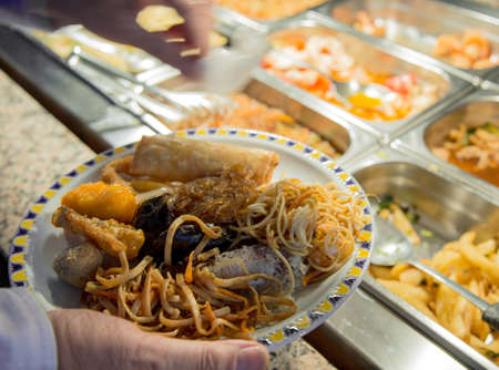 full dish of Chinese food and restaurant buffet pans photo