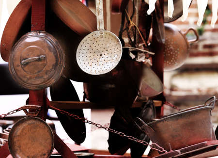 home for sale: many copper objects for kitchen and home for sale in the antiques stall at flea market Stock Photo