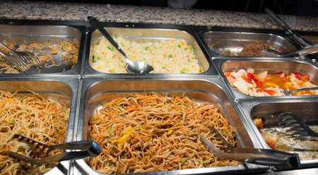 chinese dinner: buffet of spaghetti and rice with vegetables in the Chinese restaurant Stock Photo