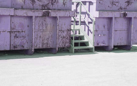 segregation: gigantic colored containers of dangerous waste landfill