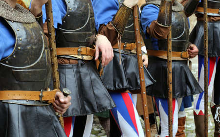 a war historian: medieval reenactment with costumed characters and ancient clothes
