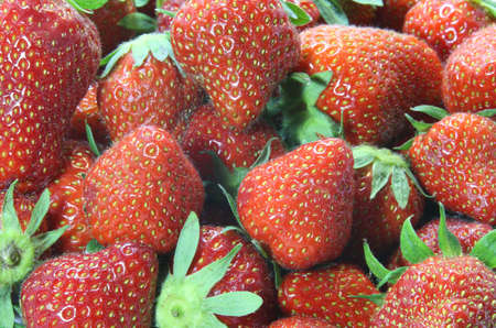 temptations: temptations: background of red ripe strawberries from greengrocers