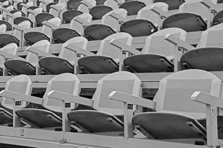absenteeism: empty chairs of iron before the theatrical