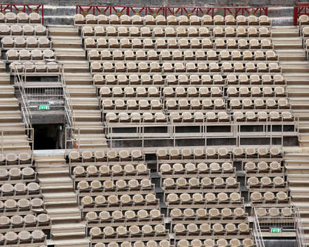 absenteeism: empty chairs of iron before the musical concert