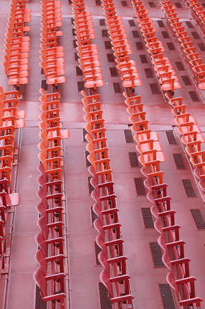 empty red chairs of iron before the musical concert