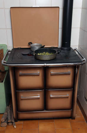 woodburning: green marrows with pot over the stove in the mountains Stock Photo