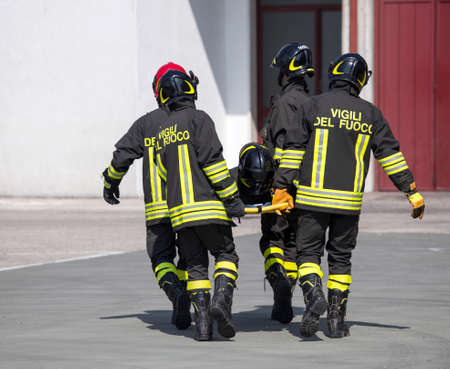 fellow: Four brave Firefighters carry a fellow firefighter with the stretcher