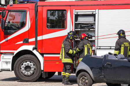 relieve: firefighters and relieve the injured in car after car accident Stock Photo