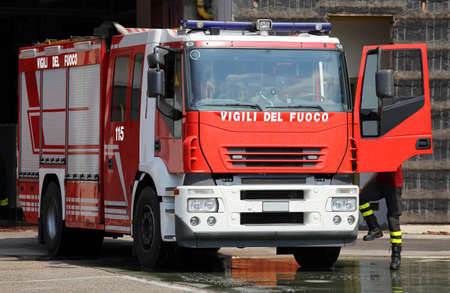 sirens: italian fire trucks with sirens blue and a fireman ready for emergency Stock Photo