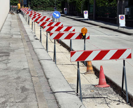 hurdles: hurdles in the construction site during the roadworks for the laying of optical fibre